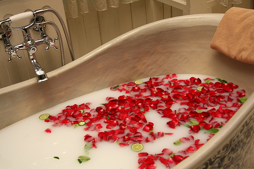 aromatherapy bath with rose petals and rose essential oil